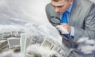 Businessman with magnifying glass on the world.jpeg
