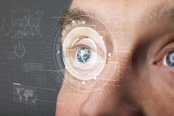 Modern cyber man with technology eye looking