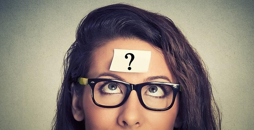 thinking woman with question mark on gray wall background-458806-edited.jpeg